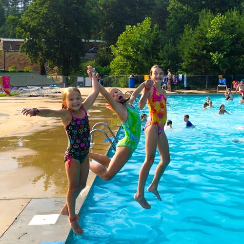 kids jumping into pool