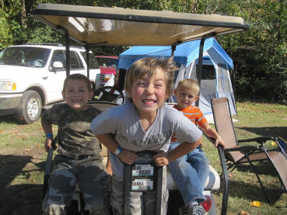kids having fun on a golf cart