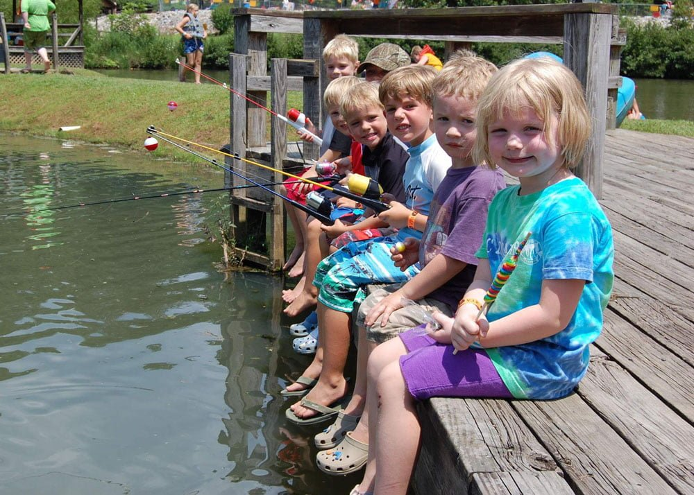 young children fishing on a dock