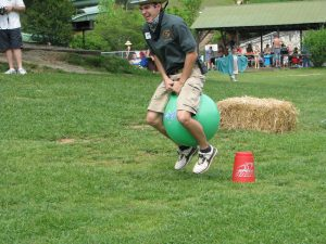 man jumping on a bouncy ball