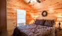 master bedroom in cabin with wreath